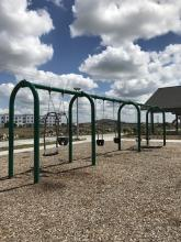 This image shows the swings at Urban Plains Park.