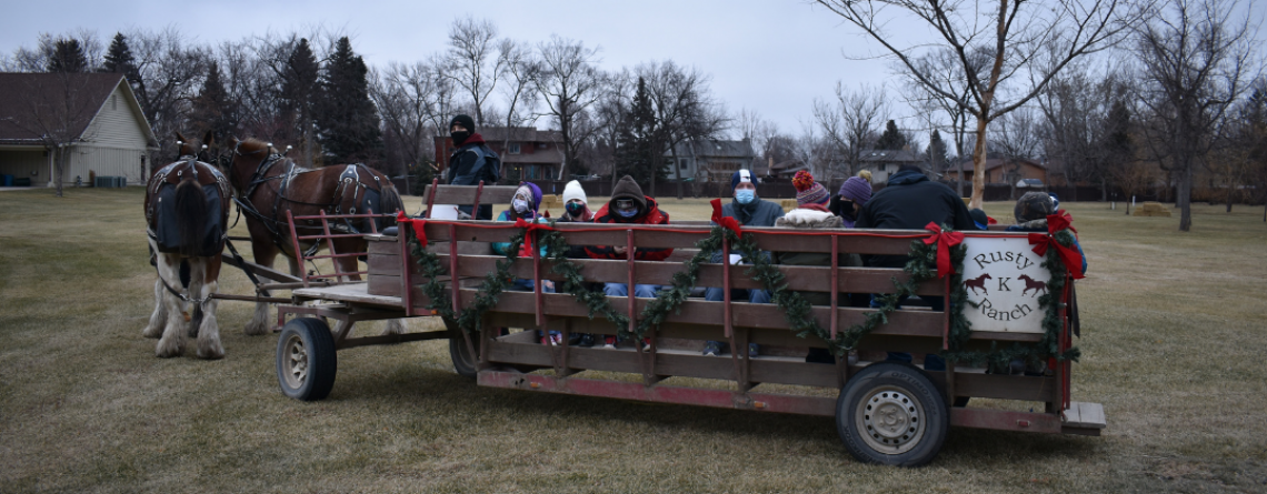 This image shows people on a sleigh ride at Santa Village.