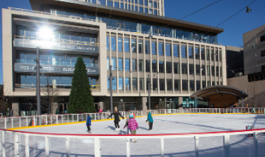 This image shows people skating on the rink at Broadway Square.