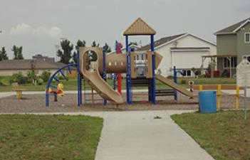 This image shows the playground at Autumn Fields Park.