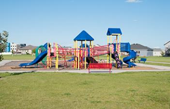 This image shows the playground at Brandt Crossing Park & Dog Park.