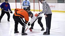 This image shows the faceoff during adult broomball.
