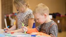 This image shows two kids coloring at Awesome Art Afternoon.