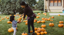 This image shows a mom and daughter picking out a pumpkin at Fall in Fargo.