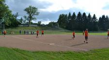 This image shows players on the entire field during kickball league.