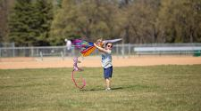 This image shows a girl getting ready to fly her kite at Kids to Parks Day.