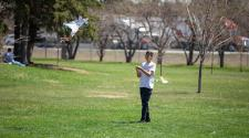 This image shows a boy starting to fly a kite at Kids to Parks Day.