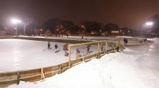This image shows two outdoor ice rinks with people skating on them.