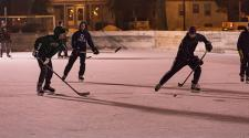 This image shows a people playing hockey during S'mores and More.