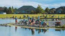 This image shows all the participants around the pond at Trout Fest.