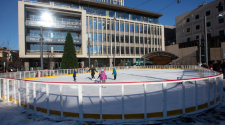 This image shows people skating on the ice at Broadway Square.