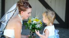 This image shows the bride and flower girl before the wedding at Trollwood Park.