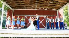 This image shows a wedding ceremony on the barn stage at Trollwood Park.